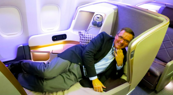 BAT editor Chris McGinnis testing out Singapore's new business class seat