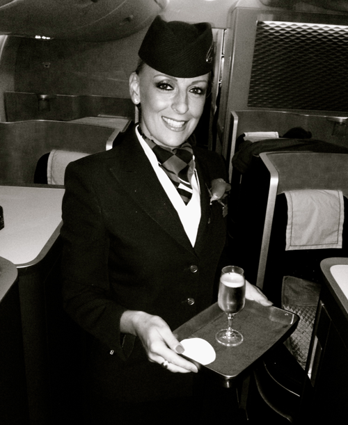 First class flight attendants pass pre-flight glasses of Laurent Perrier Grand Seicle Champagne (Chris McGinnis)