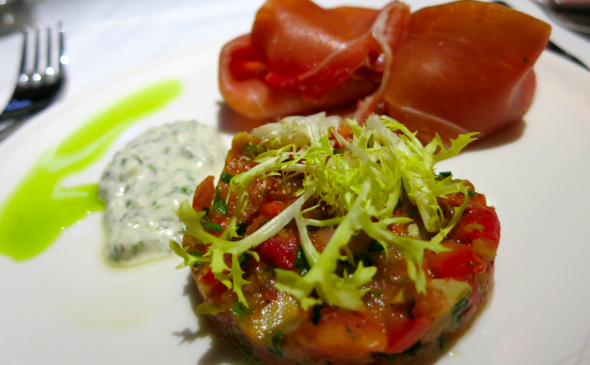 "This is ""12 month aged serrano ham with roasted tomato timbale & shallot dressing"" in first class (Chris McGinnis)"