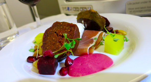 "A business class starter: ""Oxspring cured ham with spiced black fig & goat's curd salad."" (Chris McGinnis)"