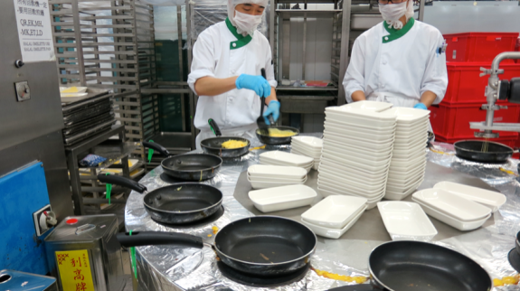Omelets are made by hand in Cathay's massive, sterile kitchens (Photo: Nancy Branka)