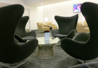 Clusters of egg chairs lend a mod feel to the temporary mezzanine club at SFO  (Photo: Chris McGinnis)