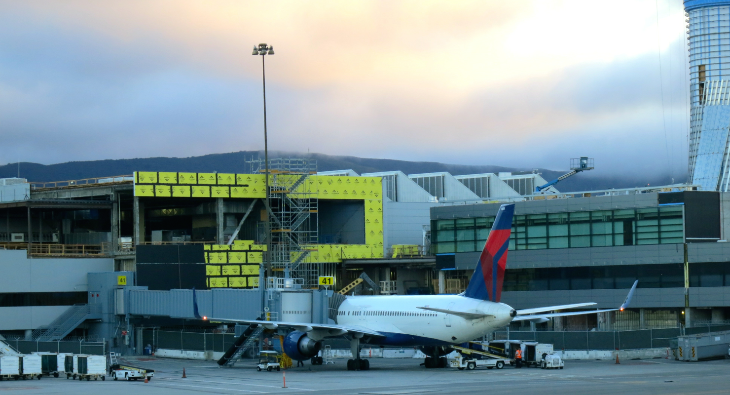 Delta's new post-security Sky Club rising in the shadow of SFO's new ATC Tower (Photo: Chris McGinnis)