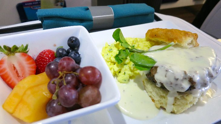 A big hot breakfast included fruit, savory beef patty on a biscuit w gravy (!) & eggs (Photo: Chris McGinnis)