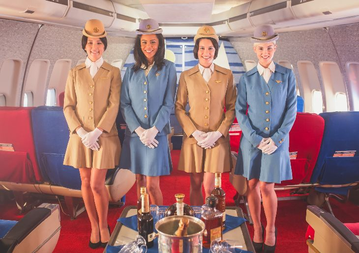 """Stewardesses"" in vintage uniforms carve chateaubriand seatside on the Pan Am Experience (Photo: Michael Kelley)"