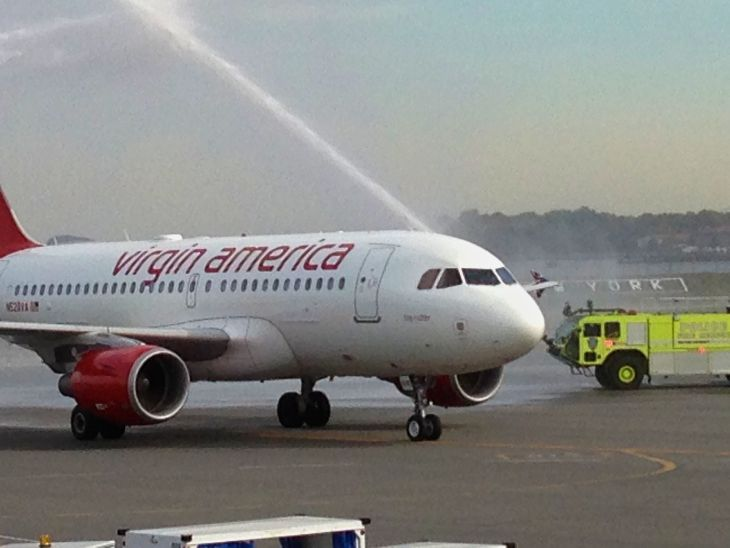 Virgin America get a ceremonial squirt with its inaugural flight from Dallas to New York La Guardia (Photo: Virgin America)