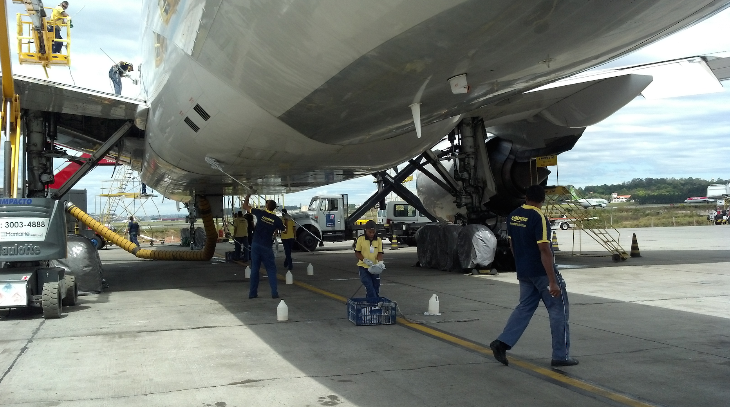 Washing the underbelly of a United Airlines jet-- it takes a lot of elbow grease! (United Airlines)