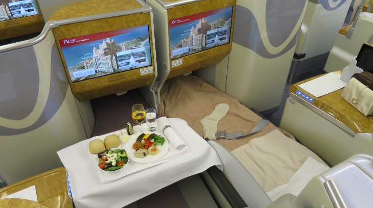 Two center business class seats- one set up for dining, the other for sleeping (Photo: Chris McGinnis)