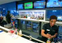 Bartenders on duty at Delta's Sky Club in Atlanta (Photo: Chris McGinnis)