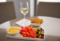 Hummus, sliced peppers, olives and pretzel crisps for afternoon snacking (Photo: United)