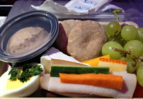 "Virgin America's ""kinda"" paleo protein plate for sale in economy includes turkey, veggies, egg, hummus, cheese. grapes and pita (Photo: Chris McGinnis)"