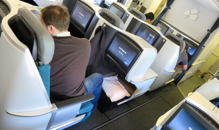 Note how passenger is exposed to aisle without console (Photo: Chris McGinnis)
