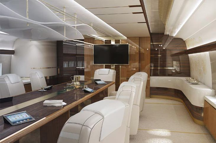 Need to call the board members down from their sleeping berths for an emergency meeting? The 747-8 comes with a full-featured conference room that doubles as a dining room.