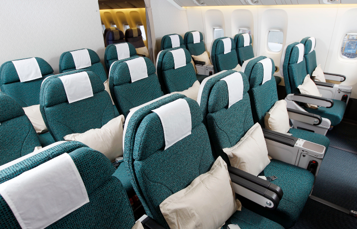 Note the double arm rests between seats in Cathay's premium economy (Cathay Pacific)