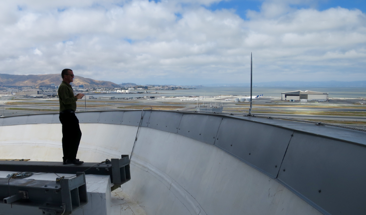 Your excited TravelSkills editor Chris McGinnis pondering a lightening rod on the top of SFO control tower (Doug Yakel)