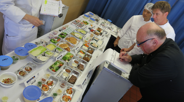 Singapore Airline's executive chef inspects 95 meals at an airport catering kitchen (Chris McGinnis)
