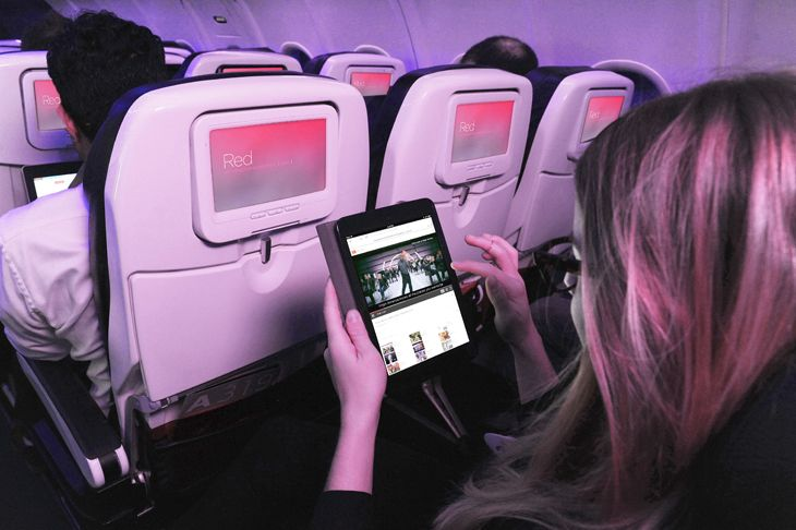 A Virgin America passenger logs onto her iPad. (Image: Virgin America)