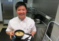 Cathay's noodle bar chef Ivy Tran serves up steaming bowl of Dan Dan noodles (Photo: Chris McGinnis)
