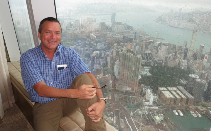 Chris in a window seat at the Ritz-Carlton overlooking typhoon swept Hong Kong (Photo: B Dean)