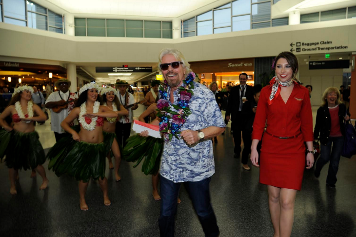 Branson arrives at SFO in aloha shirt (Virgin America)