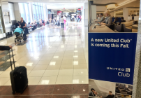 A sign on ATL's T-gates concourse announcing the new United Club (Photo: Chris McGinnis)