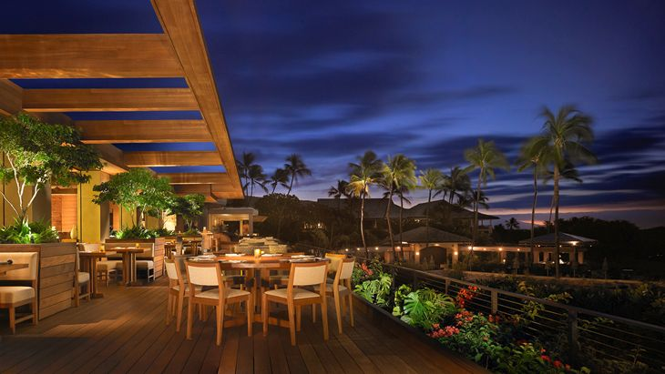 An outdoor terrace at the Four Seasons Resort Lanai. (Image: Four Seasons)