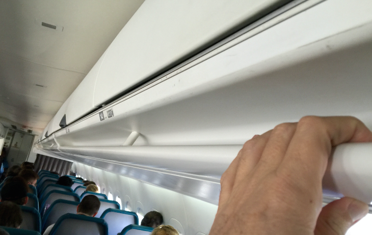 Smart: Grab the bar instead of the seatback when maneuvering in or out of seats on Hawaiian Air's B717s (Photo: Chris McGinnis)