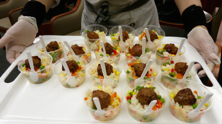 A friendly attendant passes around cups of fried rice that hits the spot at 10 pm (Chris McGinnis)