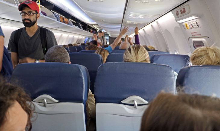 Did you walk through first class to get to your coach seat? Then don't drink too much on the flight. (Image: jiom Glab)