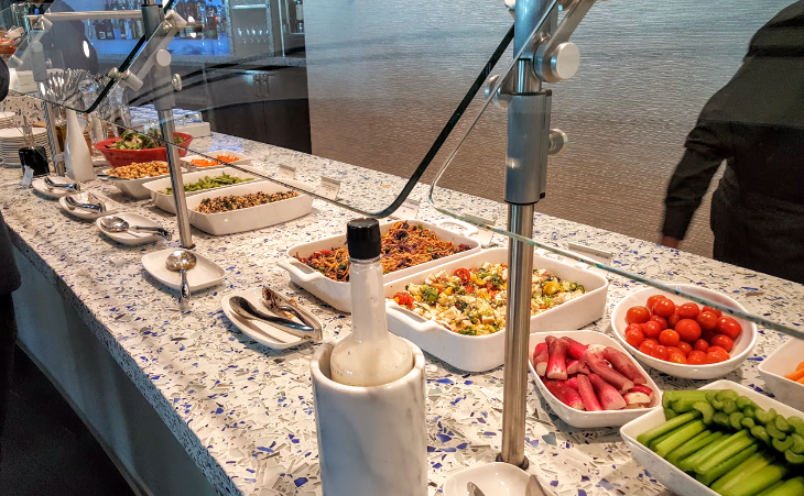 Salads, crudite, and other food options at the SEA Skyclub