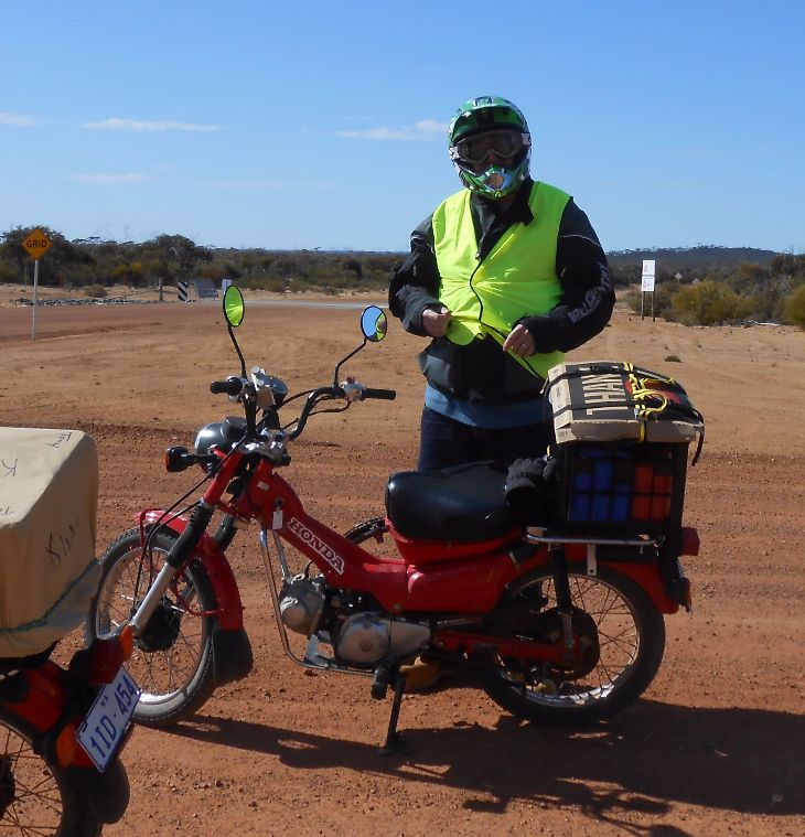 Dan Knous and his Honda CT-110 near Meekathara, Western Australia