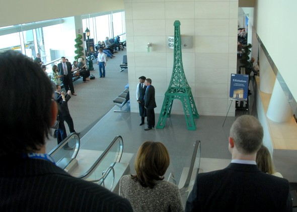 Passengers on United's inaugural Paris flight greet by a 12-ft Eiffel Tower & free French inspired food & drink. (Photo: United)