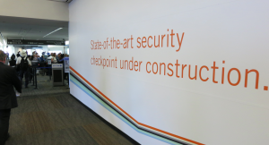 The walls obscuring construction of SFO's T3 Premium security checkpoint (Chris McGinnis)