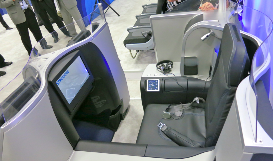 "JetBlue's new Mint seat with 15 "" screen and sliding door that creates semi-private cabin (Chris McGinnis)"