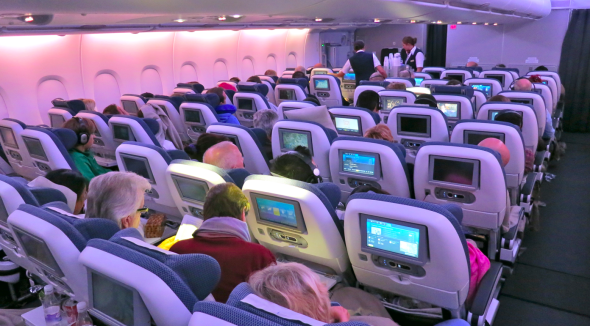 In economy class, seats are configured 3-4-3. Each seat has a large video screen with hundreds of options (Chris McGinnis)