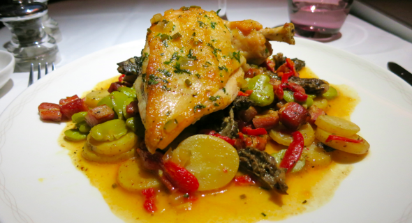 "Wow! Check out the superb presentation of ""Herb roasted organic chicken with a morel fava & pancetta ragout"" for first class passengers (Chris McGinnis)"