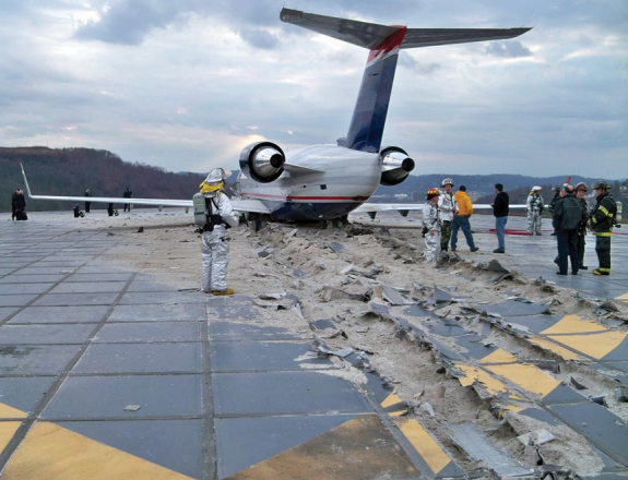 The engineered material arresting system – or EMAS – uses crushable concrete placed at the end of a runway to stop an aircraft that overruns the runway. The tires of the aircraft sink into the lightweight concrete and the aircraft is decelerated as it rolls through the material (Engineered Arresting Systems Corporation)