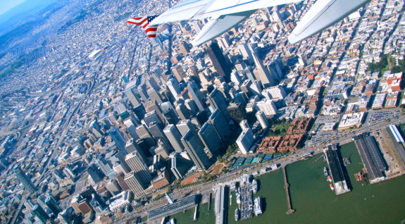 Virgin America's star spangled wingtip over downtown SF. What a sight! (Photo: Chris McGinnis)