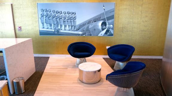 Conversation nook in United Club along with vintage photos (Chris McGinnis)