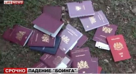 A pack of passports allegedly found on the ground at the crash site