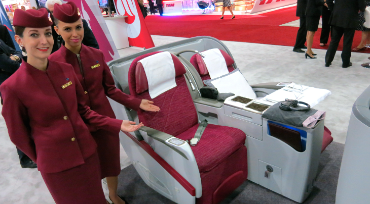Here's Qatar Air's business class seat. All the UAE carriers had their most gorgeous FA's on hand to show off the seats! (Chris McGinnis)