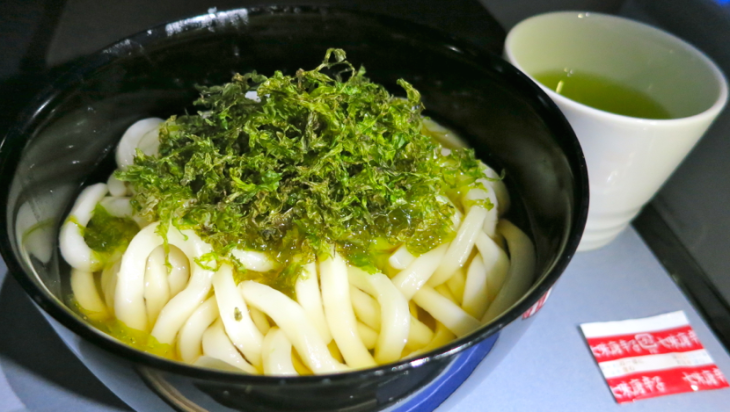 I loved this homey and tasty snack of udon noodles in broth and topped with dried seaweed served mid-flight (Chris McGinnis)