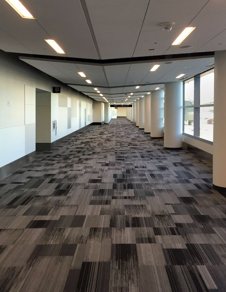 Here's a look down the new sterile corridor connecting T1 and T2 (Fentress Architects)