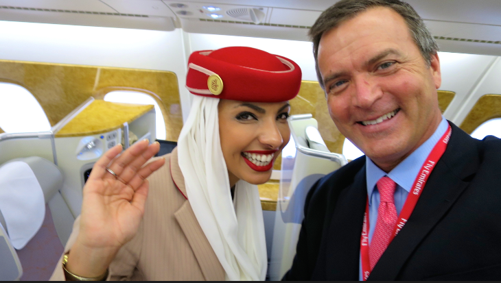 TravelSkills editor Chris McGinnis having fun with Emirates flight attendants during the A380 tour at SFO