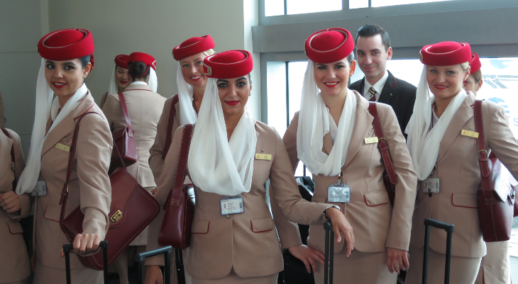 Emirates glam crew waiting to board the aircraft for the 16 hour flight to DXB (Photo: Chris McGinnis)