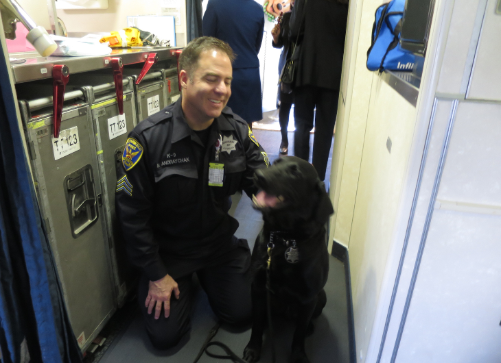 SFPD Airport Bureau bomb-sniffing dogs like Big and his handler, Sgt. Michael Andraychak, were just along for the fun of it.