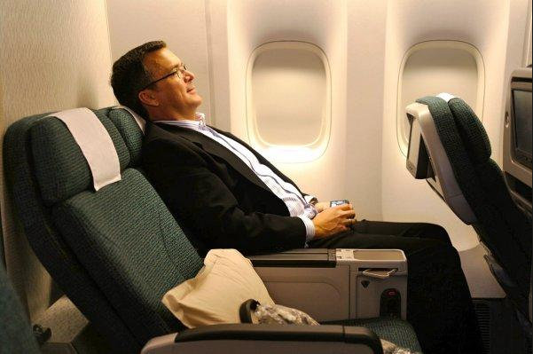 TravelSkills editor Chris McGinnis leaning back in Cathay's premium economy seat (Photo: David McIntyre)