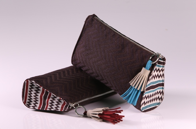 Etihad amenity kits feature colorful Sadou patterns pa centuries-old Abu Dhabi weaving craft. (Photo: Etihad)