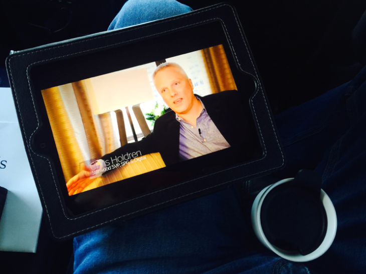 Watching an iPad video about the promo (Photo: Chris McGinnis)