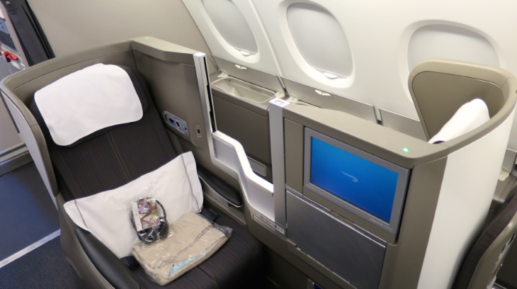British Airways' signature forward & rear facing business class seat. Note window bins on upper deck (Chris McGinnis)